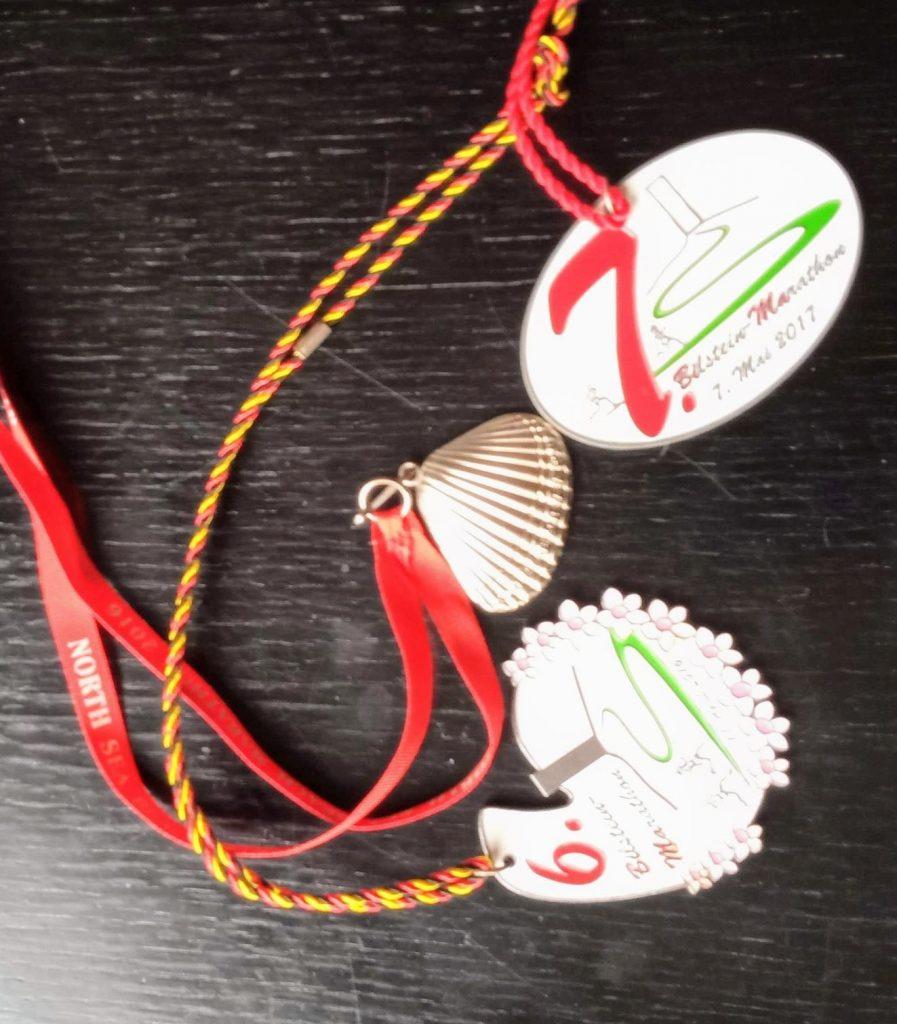 Drei Medaillen für Marathons - als Beleg für meine sportlichen Ziele