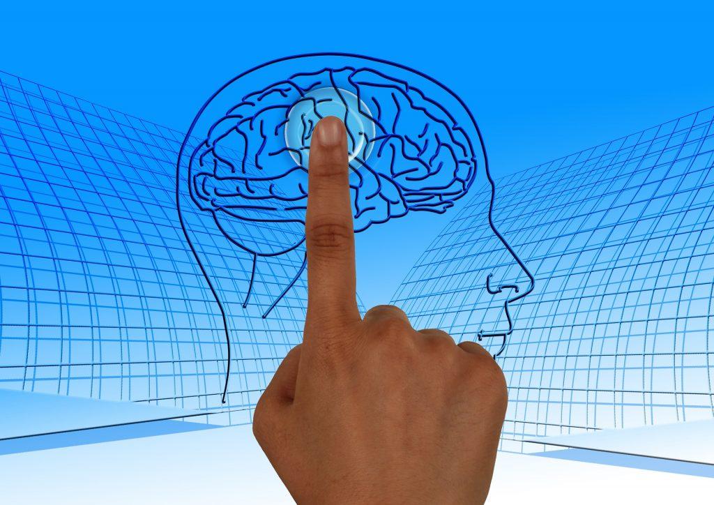 Ein Finger zeigt auf ein Gehirn - Synonym für den Mindfuck: Lieber gar nicht machen als schlecht machen.